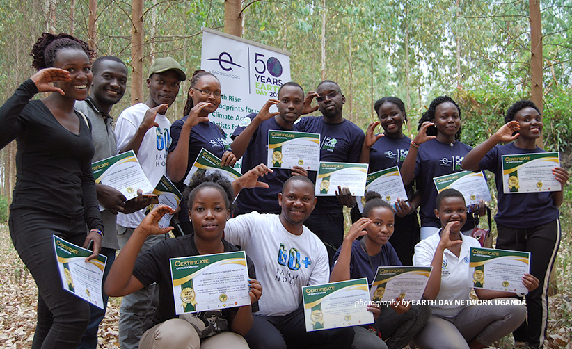 Photo of Earth Day Network Uganda Coordinator Derrick Mugisha with volunteers during environmental event