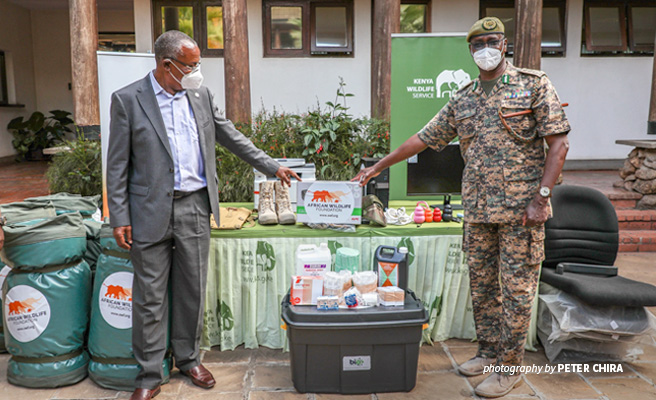 Photo of Dr Philip Muruthi handing over equipment for AWF-supported Lake Nakuru National Park KWS Canine Unit