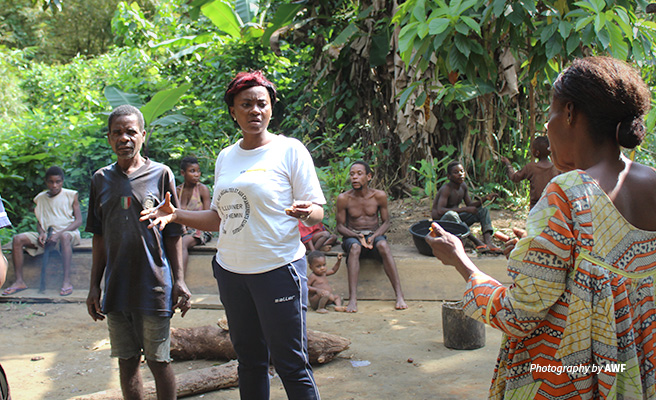 Photo of AWF Project Officer Stefany Noumeyi training community members in Campo Ma'an National Park