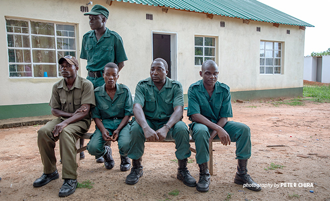 Mbire community wildlife scout Shylet Mugonapanja with colleagues