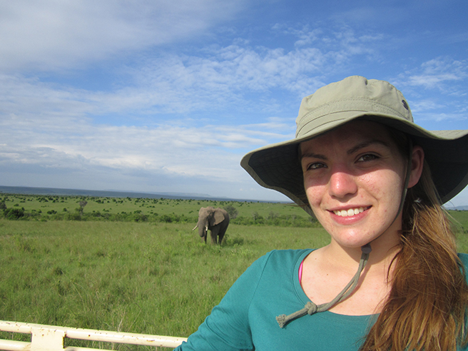 A photo of GMU student Andrea Broad with an elephant while on safari. Photo by: Andrea Broad