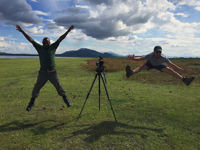 Dan Duran jumping for joy at Lake Burunge wit an anti-poaching scout
