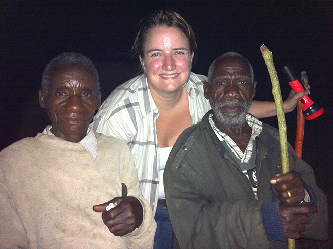 Anne-Marie Weeden with Batwa elders on a nocturnal forest walk. Photo by Nick Ball