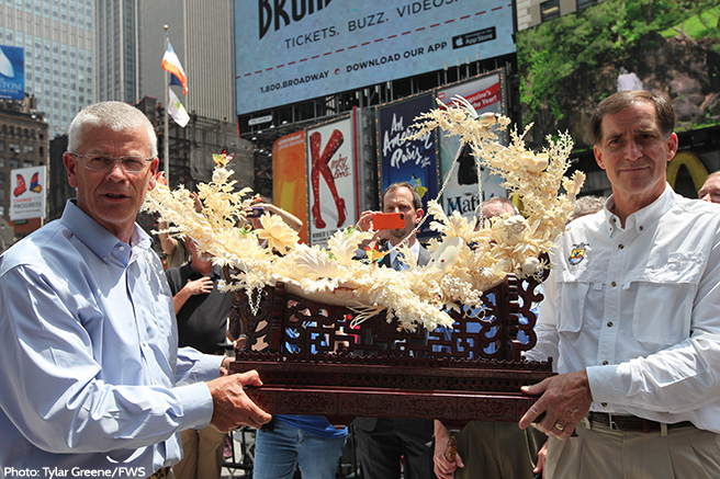 USFWS's Dan Ashe and William C. Woody with the Last Piece of Ivory to be Crushed