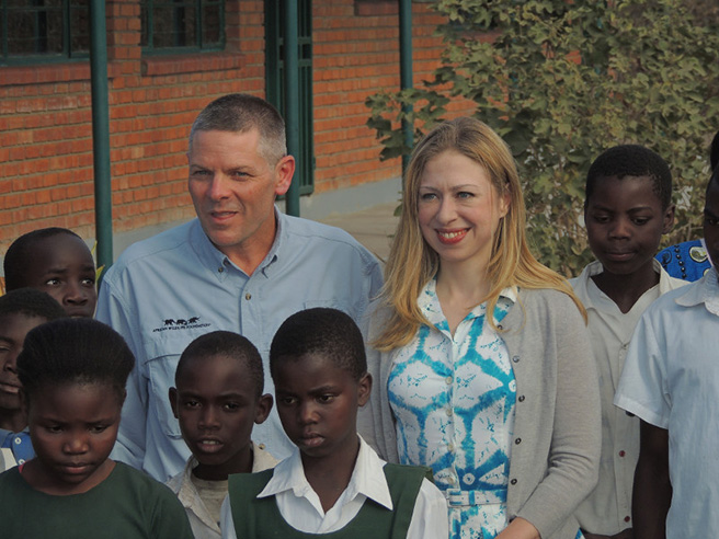 Chelsea Clinton, vice chair of Clinton Foundation, with African Wildlife Foundation CEO Patrick Bergin and Lupani Primary School children in August 2013