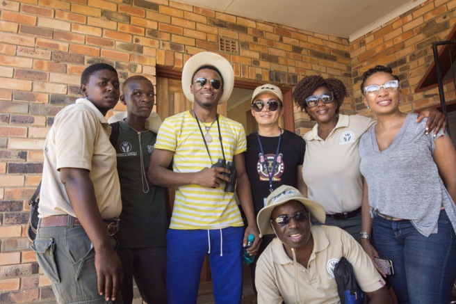 Alikiba with Chinese film star Wang Baoqiang and conservationists in South Africa