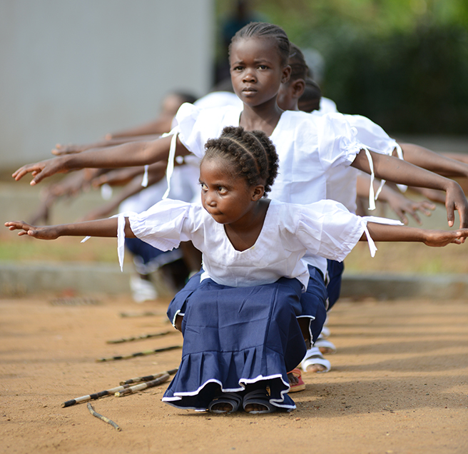 School girls perform a dance at the grand opening of the Ilima Conservation School.