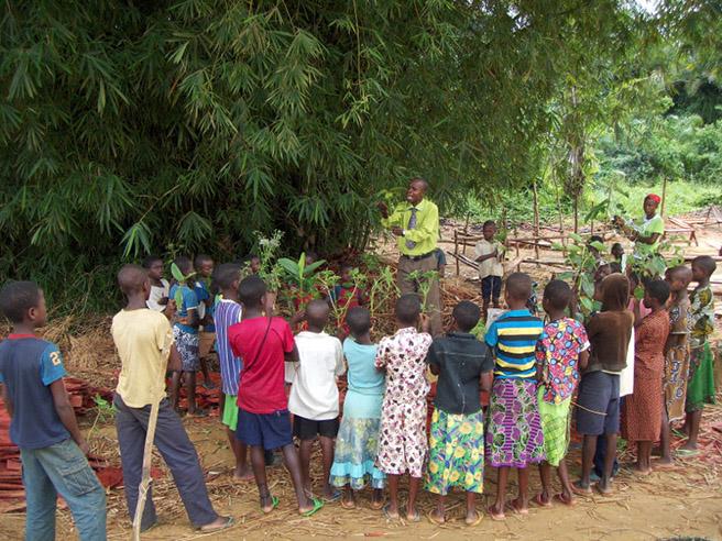 Teacher and students at Ilima School in Democratic Republic of Congo