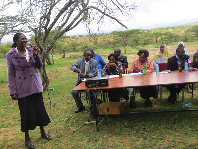 Jane Meshami, shown here addressing the general meeting for the Nasaruni Savings and Credit Cooperative Organization in northern Kenya, says this AWF project has helped the community in innumerable ways.