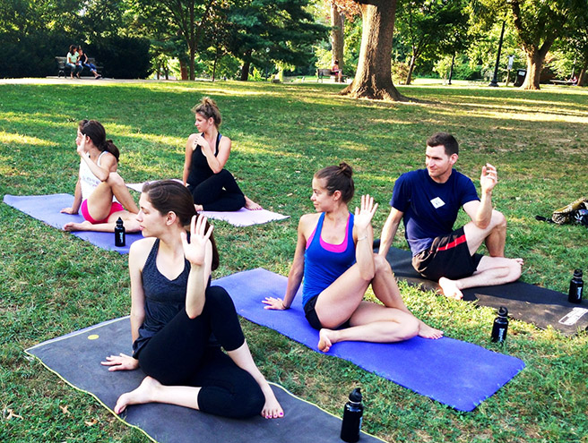 Yoga teacher and AWF employee Amy Rizzotto leads an outdoor class to raise funds for Africa Yoga Project
