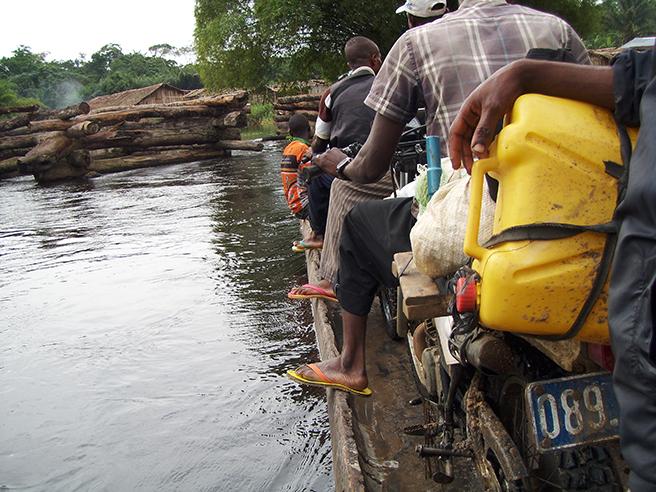 A dangerous motorbike ride across a rive to reach AWF's Congo Landscape