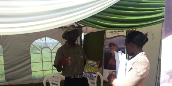 African Wildlife Foundation CMTP, George Okwaro, answering a question from an interested attendee at World Migratory Bird Day 2013