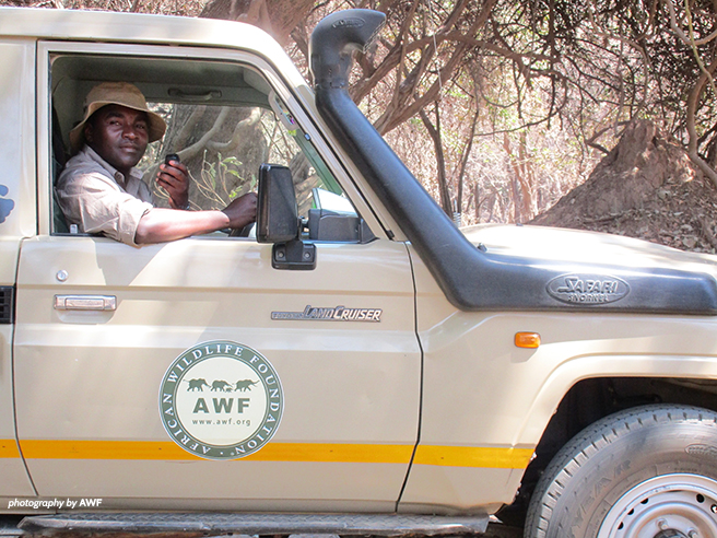 Simon Muchatibaya in an AWF Land Cruiser
