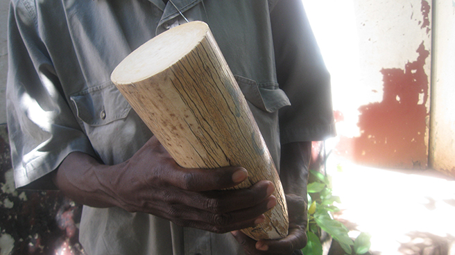 ZAWA ranger holding piece of ivory cut for shipment