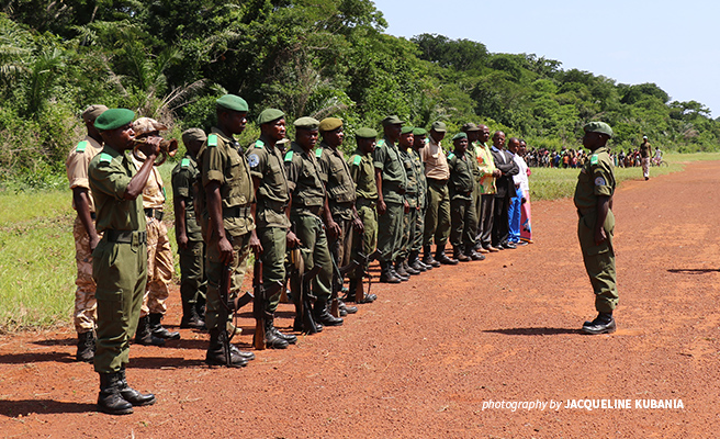 A group of rangers standing at attention at a guard of honor in the Democratic Republic of Congo