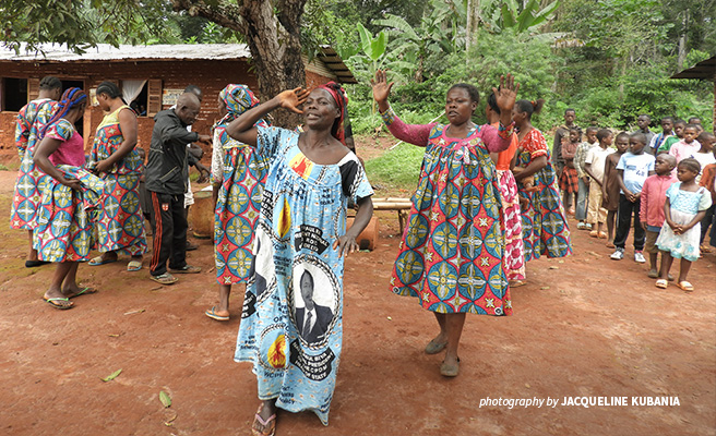 Photo of women from Kagnnole village dancing during a visit to the AWF conservation project site