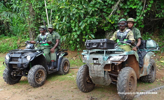 Photo of four wildlife rangers on quad bikes ready for anti-poaching patrol in Bili-Uele