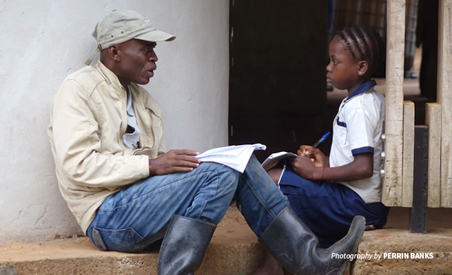 Photo of AWF Senior Field Officer in Maringa-Lopori-Wamba speaking to primary school student