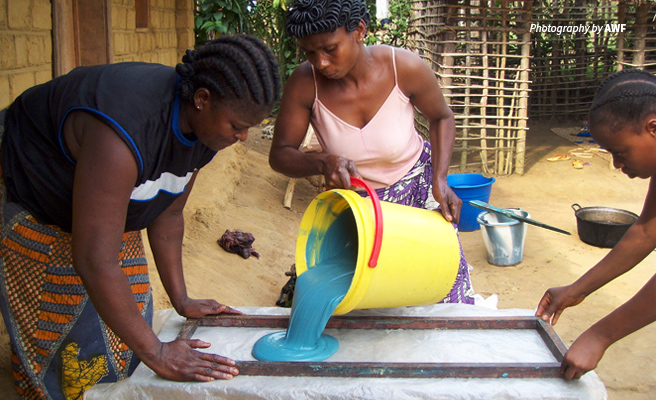 Photo of three women making soap at AWF training center in the Democratic Republic of Congo