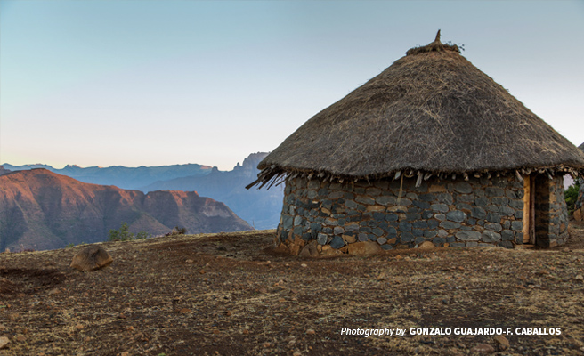 Landscape photo of hut overlooking cliff in the Simien Mountains