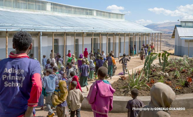 Adisge Primary School students playing in new compound repaired by AWF's Classroom Africa
