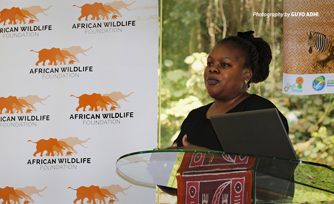 Photo of Didi Wamukoya, AWF Senior Manager, Wildlife Law Enforcement speaking at youth conference