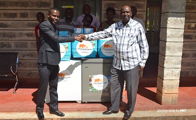 Photo of AWF Court Monitor donating evidence storage equipment to KWS Tsavo