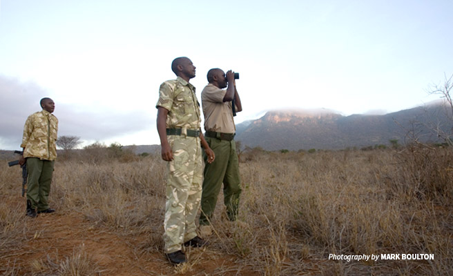 Photo of three wildlife rangers conducting a morning patrol in Tsavo, Kenya