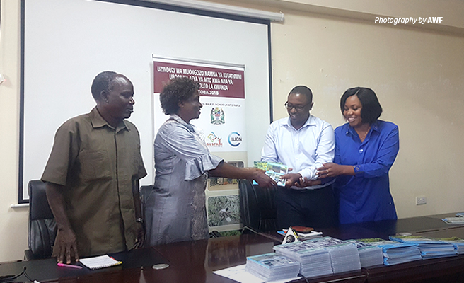 Photo of officials from African Wildlife Foundation, the University of Dar es Salaam, Tanzania Ministry of Water, and Rufiji Basin Water Board at launch of TARRISfupi