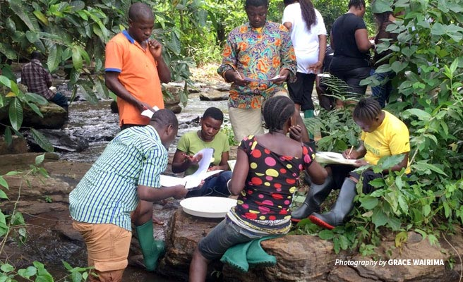 Group of community members assessing river quality in Kiolmbero, Tanzania