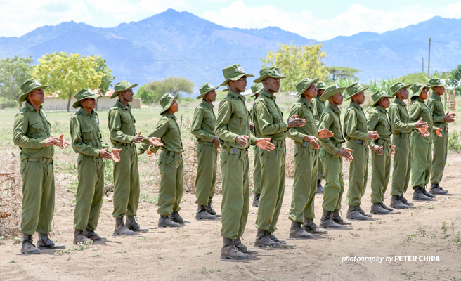 Photo of trained Tanzanian community scouts at graduation ceremony in Toloha