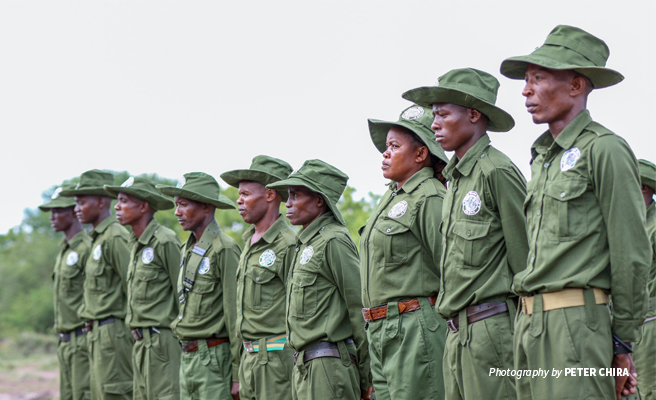 Photo of AWF-trained community wildlife conservation scouts at graduation in Tanzania