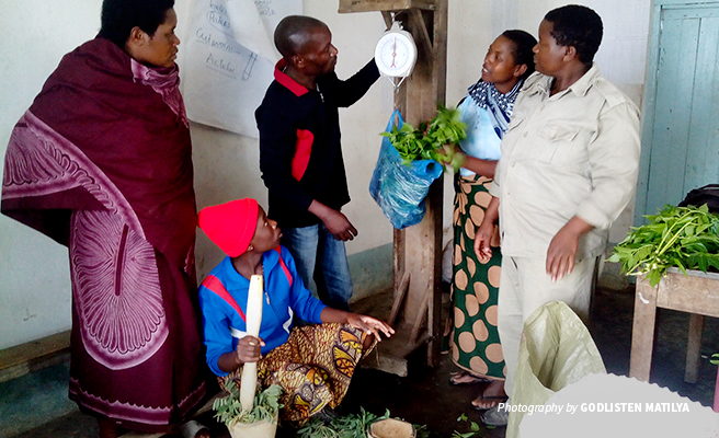 Photo of female farmers being trained on making organic pesticides from natural materials