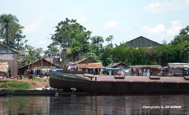 Photo of AWF-funded barge transporting agriculture produce stopped at market town on river bank
