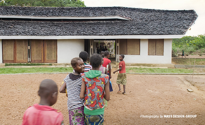 Photo of rural DRC primary school students entering new Ilima Conservation School building