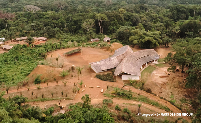 Aerial photo of Ilima Conservation Primary School adjacent to tropical forest in DRC