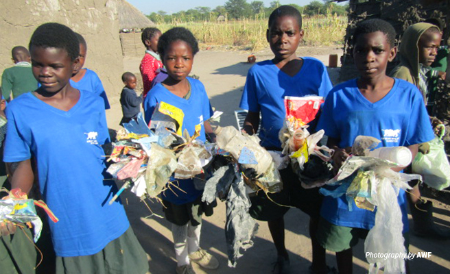 Photo of primary school children at Classroom Africa Lupani School picking litter
