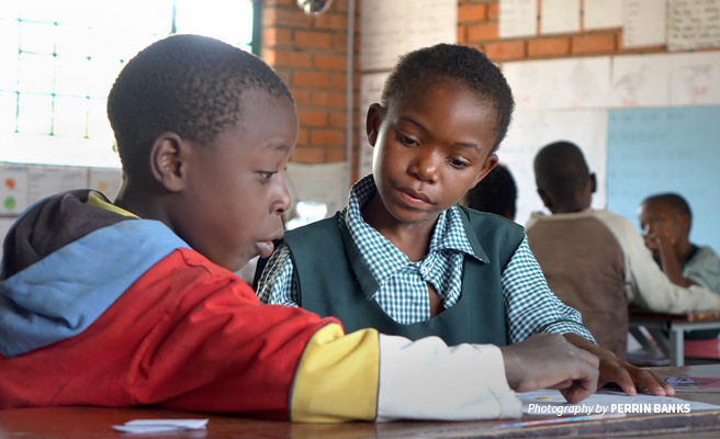 Photo of two students learning at AWF's Classroom Africa Lupani Community School