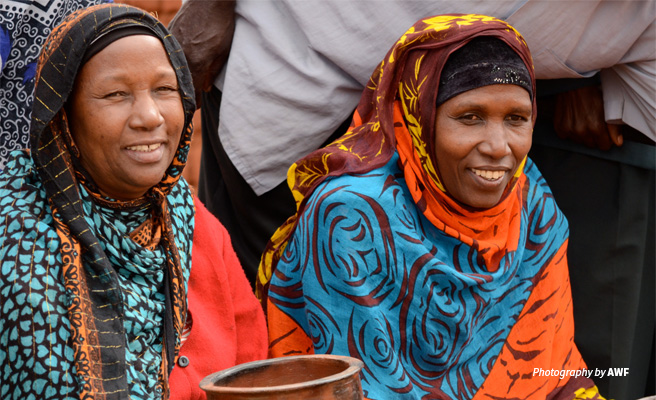 Photo of two women from rural Tanzania invovled in AWF conservation project