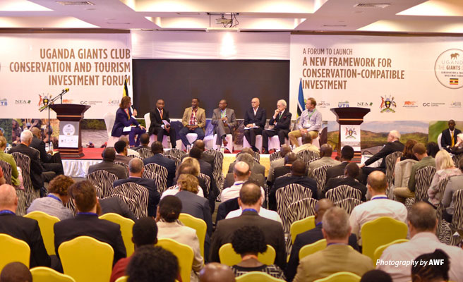 Photo of crowd and panel speakers at Giants Club Giants Club Conservation and Investment Forum