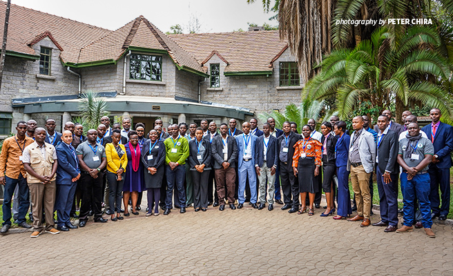 Photo of trained wildlife detection sniffer dog handlers outside AWF Nairobi HQ offices