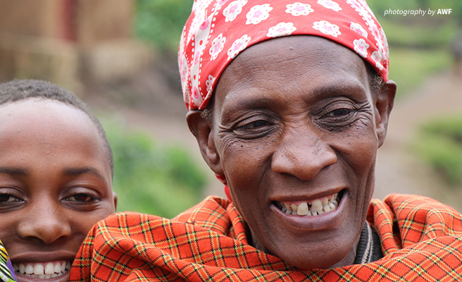 Close up photo of Rwandan woman and child smiling