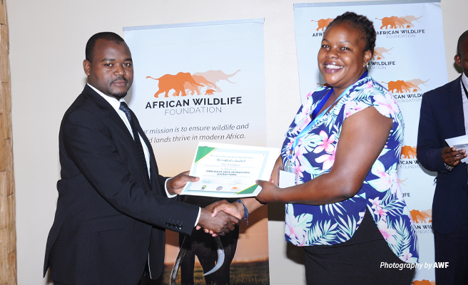 Photo of AWF and UWA representatives receiving certificate of participation in AWF Canine Evidence Retreat in Uganda
