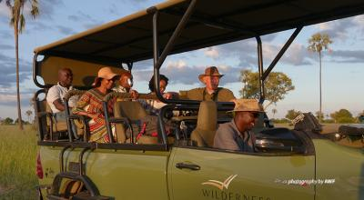 Photo of AWF staff and business leaders in safari vehicle